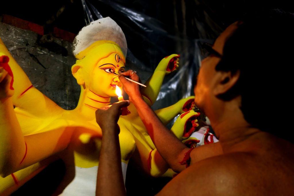 chokkhudan - artist painting the eyes of goddess Durga furing Mahalaya