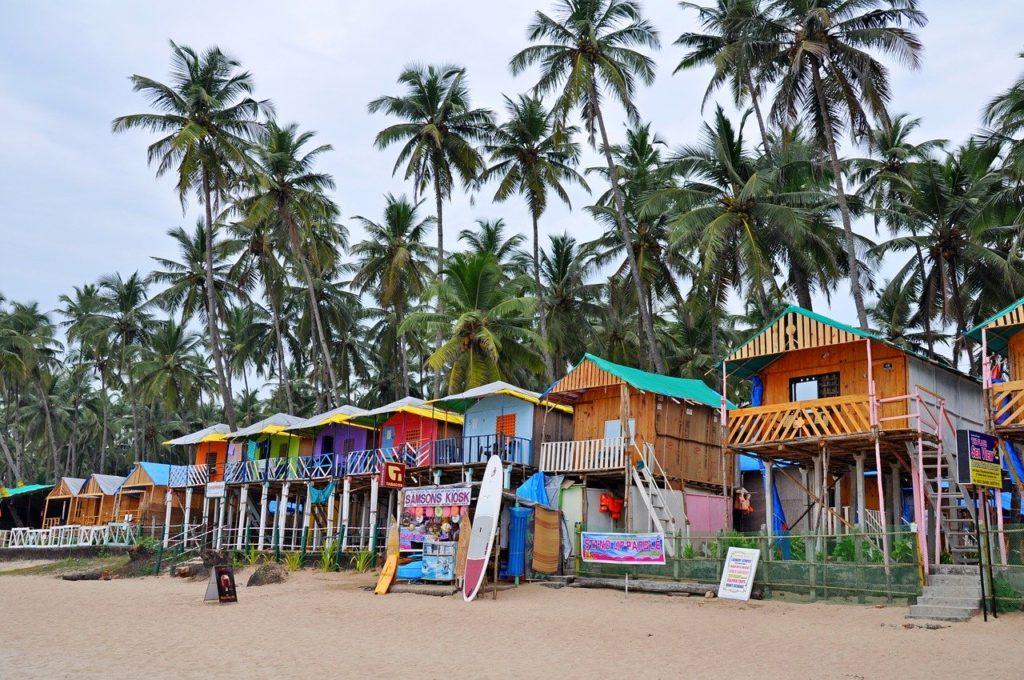 Goa beach-side shacks surrounded by palm trees